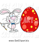 Clip Art of a White Easter Bunny Rabbit Painting a Red Dotted Egg by Hit Toon