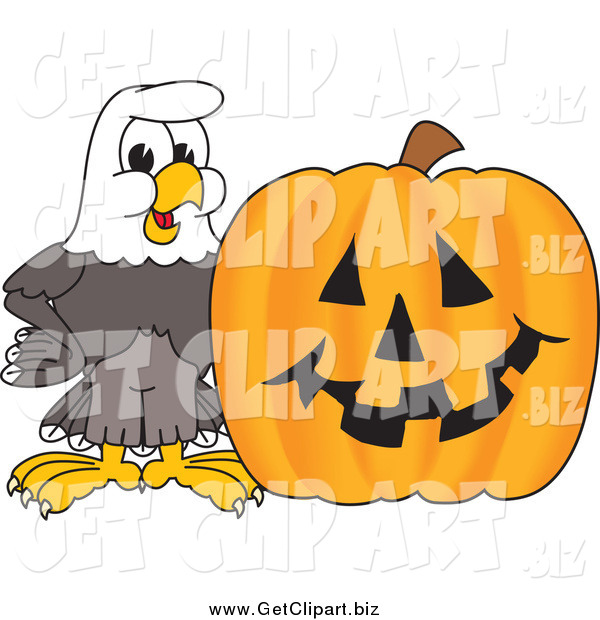 Clip Art of a Bald Eagle with a Carved Halloween Pumpkin